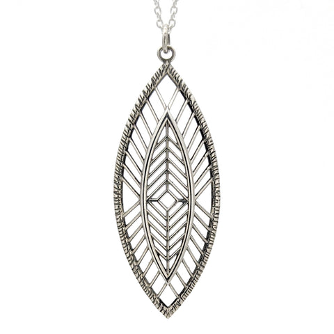 Sterling silver marquise shaped pendant with geometric lines and a handcarved texture around the border.