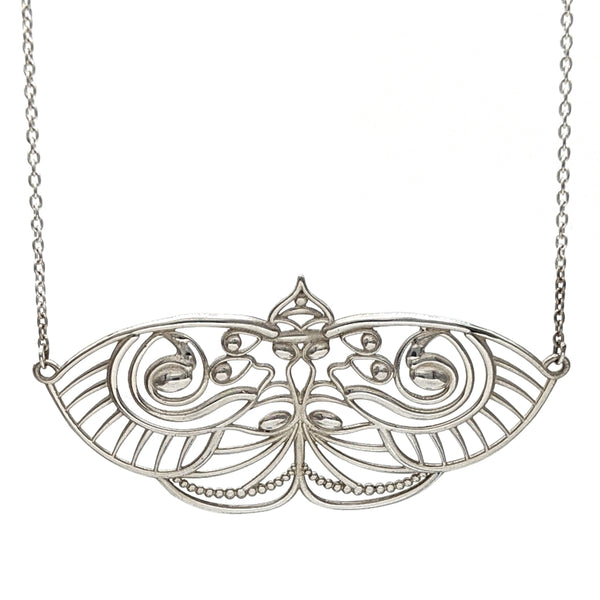 Delicate sterling silver filigree pendant in the shape of a moth.