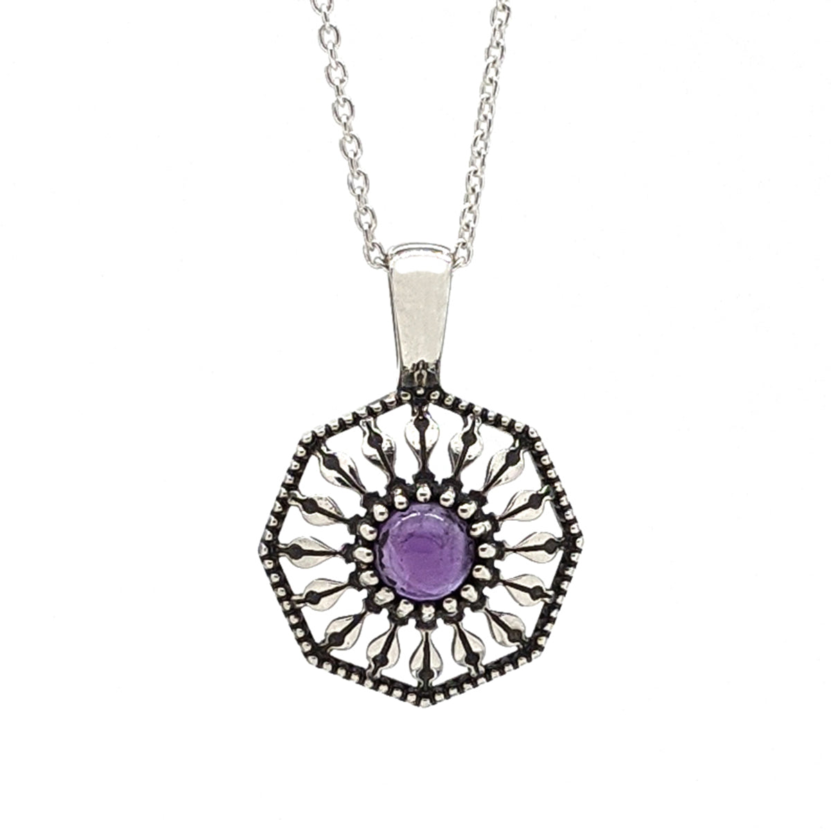 Sterling silver pendant necklace in an octagon shape with a round amethyst gemstone in the center.