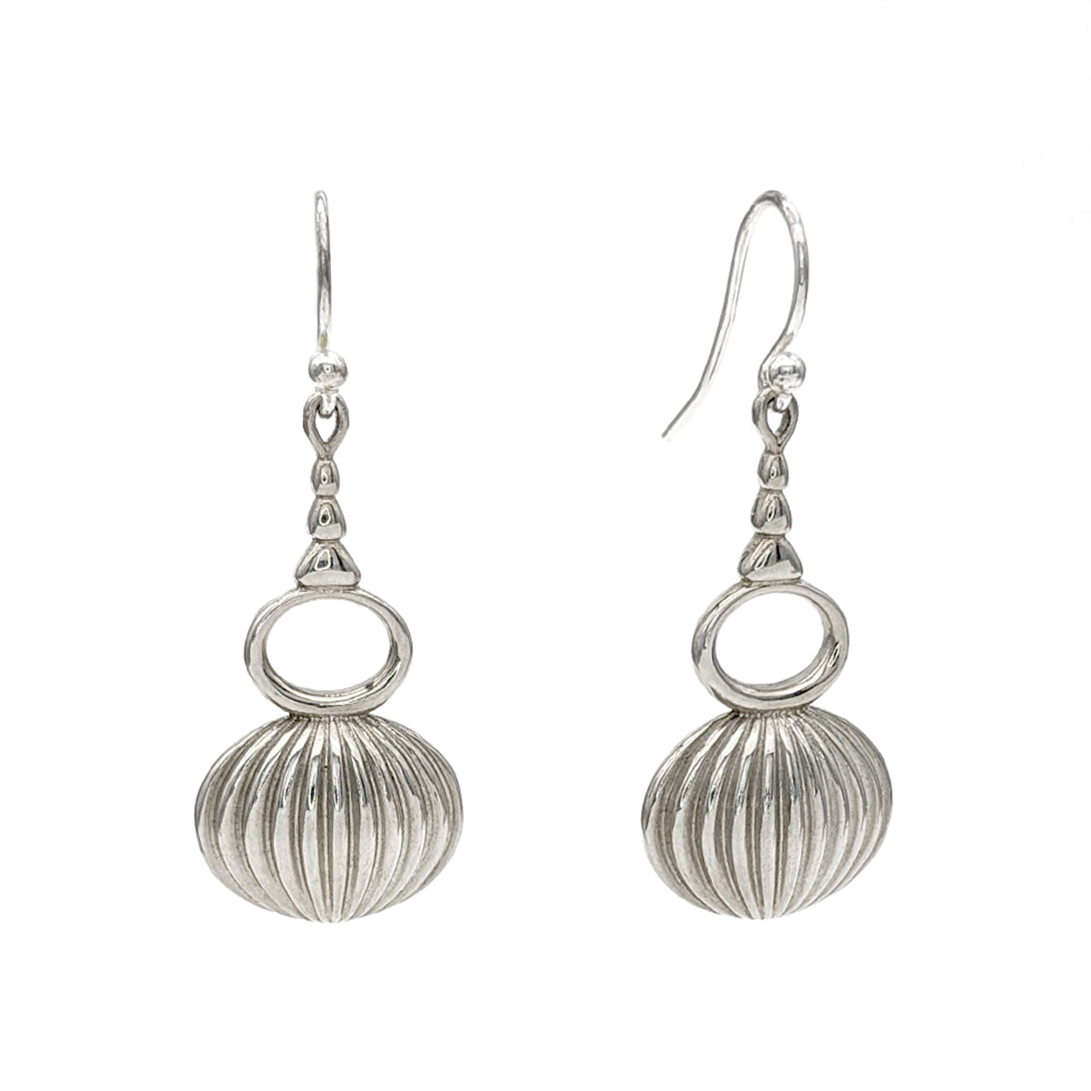 Sterling silver drop earrings with a horizontal, open oval and a ribbed oval on the bottom.