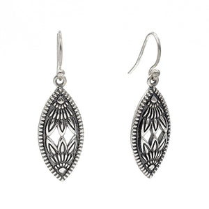 Sterling silver marquise shaped earrings with raised patterns on an oxidized background.