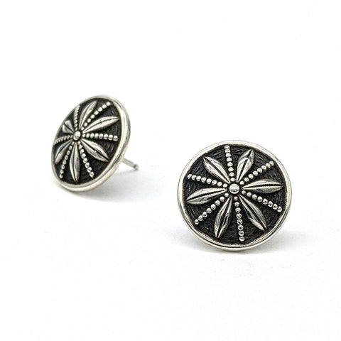 These sterling silver button stud earrings feature the radial pattern of a star anise, with delicate beaded milgrain accents.