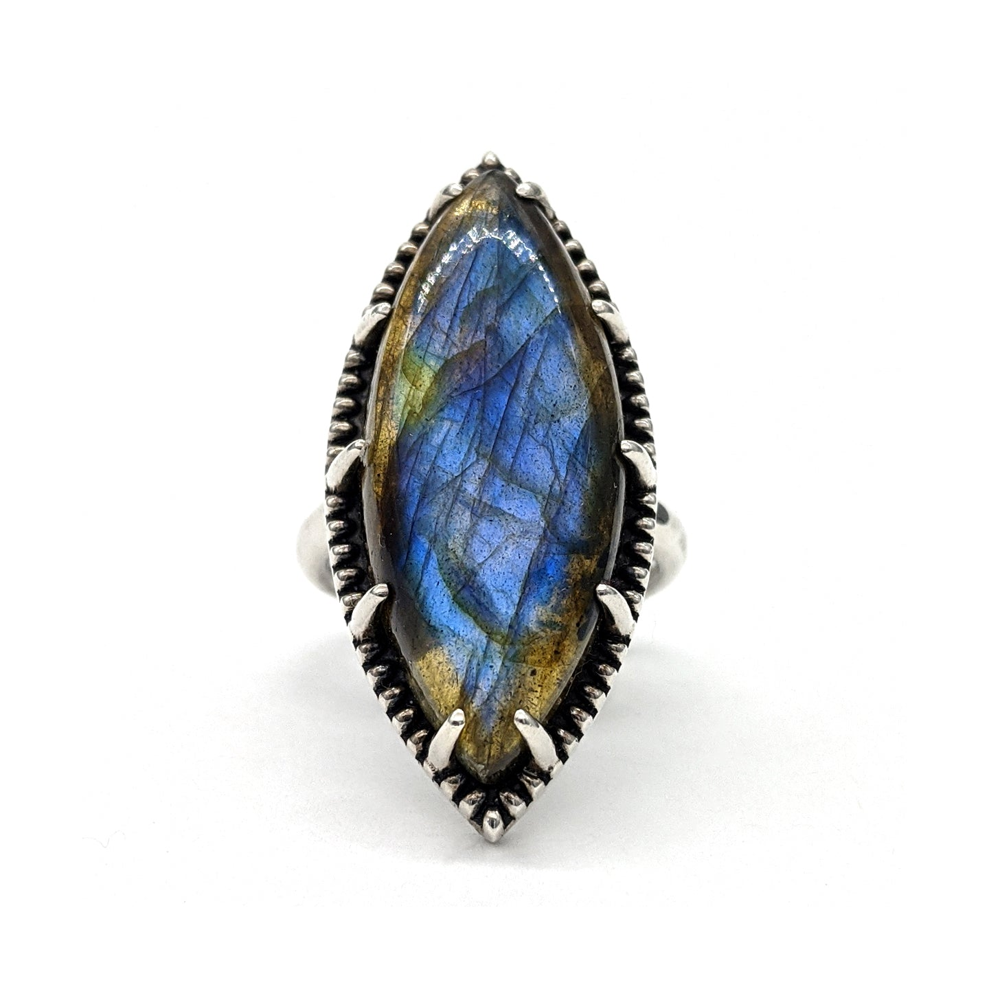 Sterling silver ring that features a blue marquise labradorite gemstone with a beaded halo.