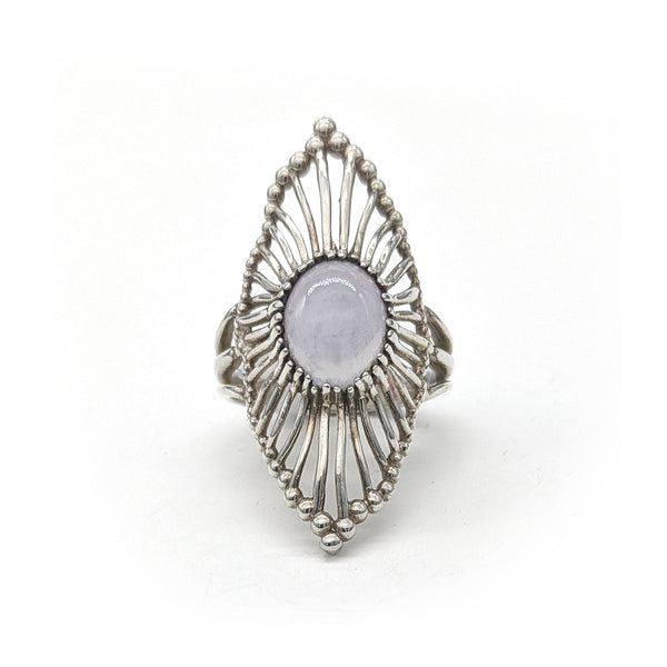 Sterling silver ring in a long marquise shape with organic wires all leading towards the center stone, an oval chalcedony.