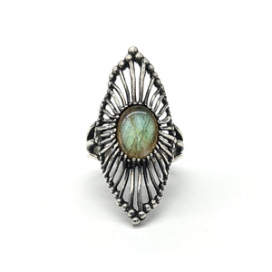 Sterling silver ring in a long marquise shape with organic wires all leading towards the center stone, an oval labradorite.