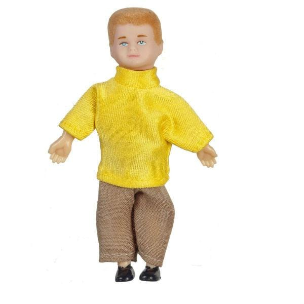 A blonde dollhouse doll who is a young boy wearing brown pants and a yellow shirt.