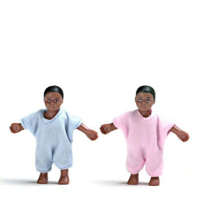 African-American dollhouse doll twins wearing nightgowns.