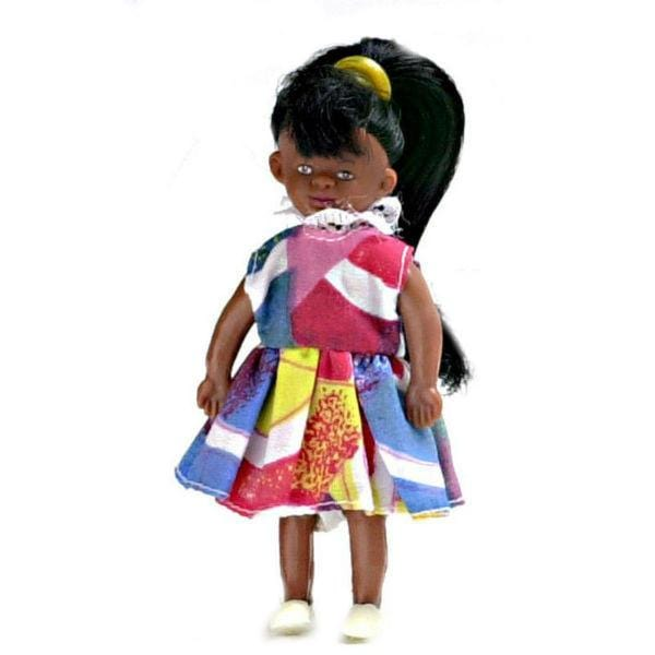A young African-American dollhouse doll with a high pony tail and colorful dress.