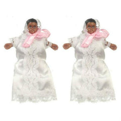 African-American dollhouse doll twins swaddled in white lace covers.