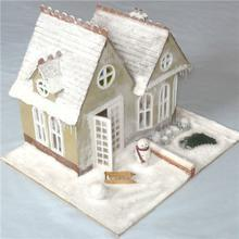 A dollhouse covered with Scenic Snowflakes.