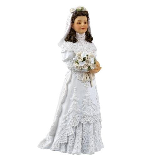 A polyresin bride dollhouse doll.