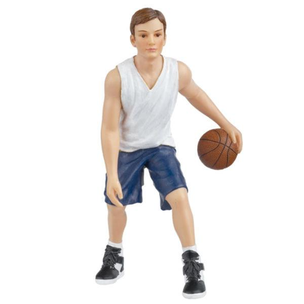 A polyresin dollhouse doll who is a young male playing basketball.