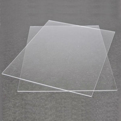 Two sheets of plexiglass for dollhouse windows and doors.