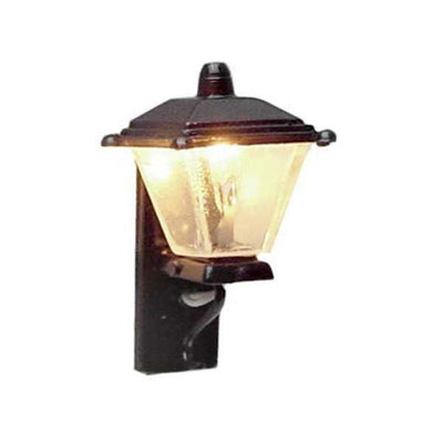 A 12 volt black dollhouse miniature coach lamp.