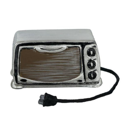 A black painted resin dollhouse miniature toaster oven.