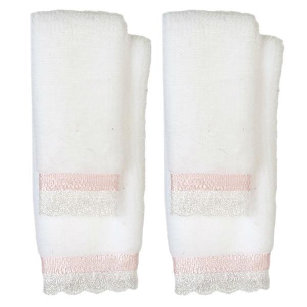 Dollhouse miniatures bath towels that are pink and white.