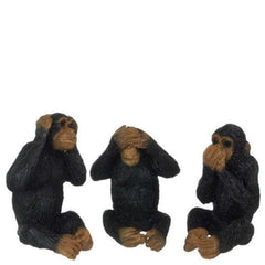 Three miniature monkeys that do actions for see no evil, hear no evil, speak no evil.