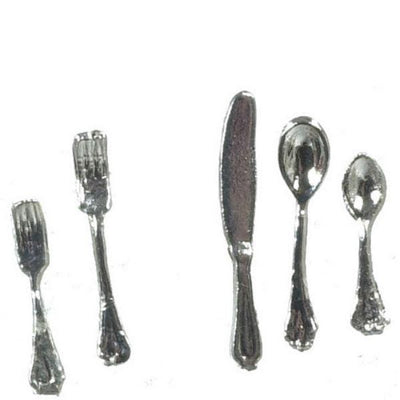 A dollhouse miniature silver flatware set with two spoons, two forks, and a knife.