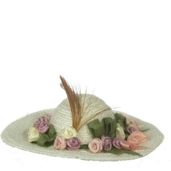 A doll hat with flowers and a feather.