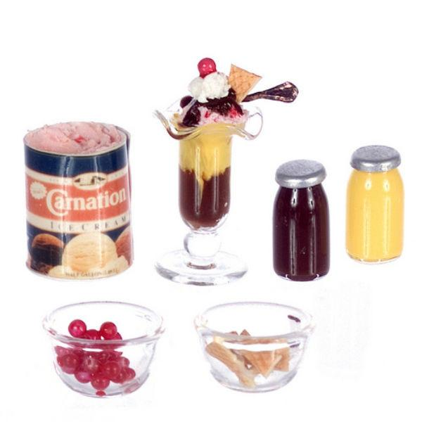A dollhouse miniature sundae set with ice cream and toppings.