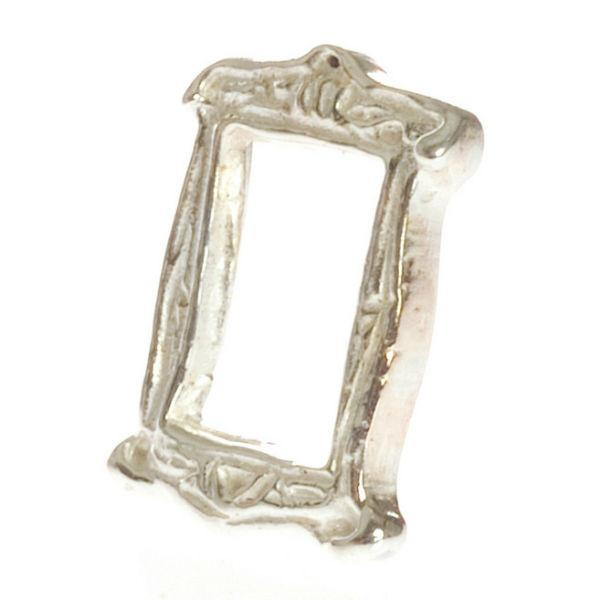 A dollhouse miniature standing silver frame.