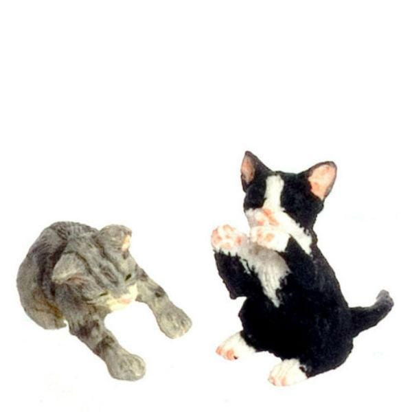 Two miniature kittens who are playing.