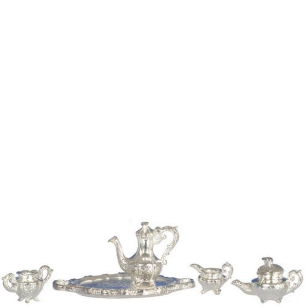 A dollhouse miniature silver tea set.
