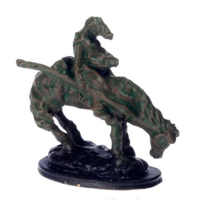 A dollhouse miniature Remington statue of a horse and rider.