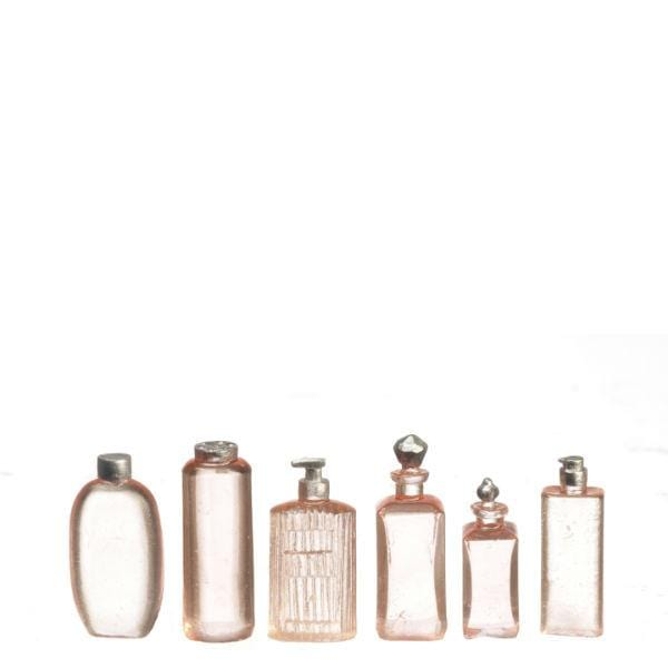 Six dollhouse miniature bathroom bottles in pale pink.