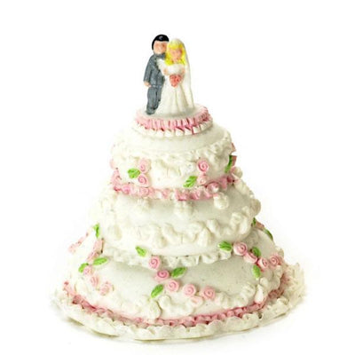 A dollhouse miniature wedding cake.