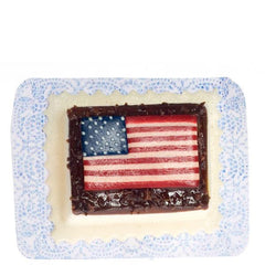 A dollhouse miniature American flag cake.
