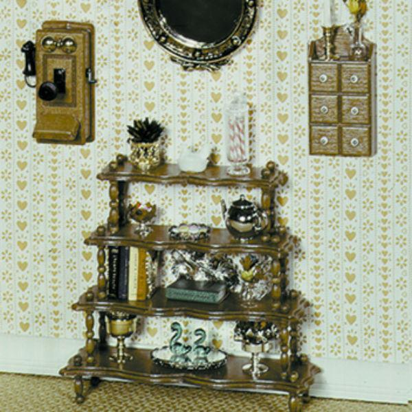 A Chrysnbon dollhouse stand set.