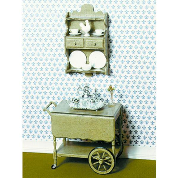 A Chrysnbon dollhouse tea cart set.