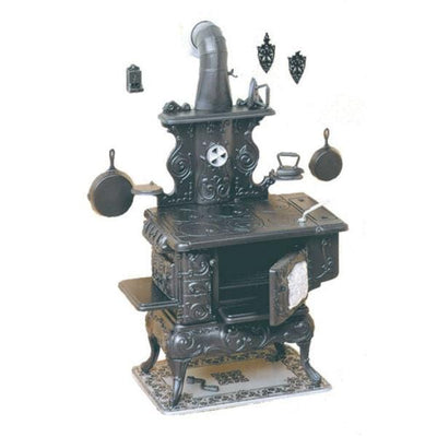 A Chrysnbon dollhouse miniature stove kit.