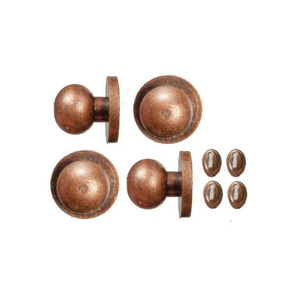 Four bronze dollhouse door knobs with keyholes.
