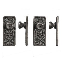 Ornate pewter dollhouse door knobs.