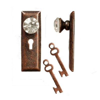 Two bronze dollhouse door knobs with keys.
