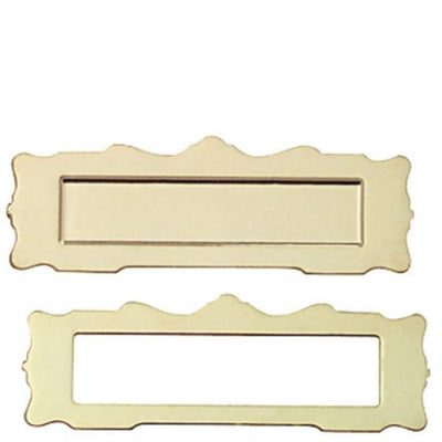 A gold dollhouse miniature mail slot.
