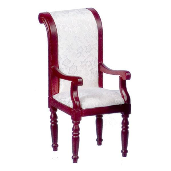 A dollhouse furniture dining chair with white fabric.
