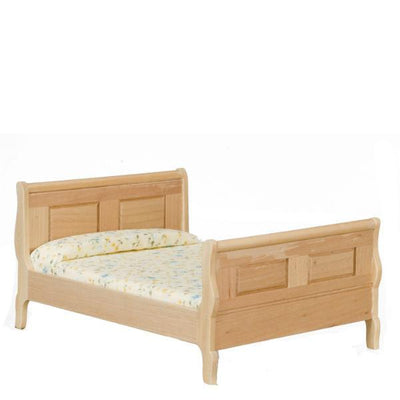 A dollhouse furniture oak sleigh bed.