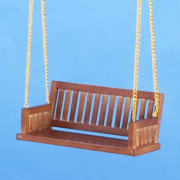 A walnut dollhouse miniature porch swing.