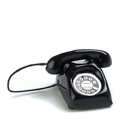 A dollhouse miniature black rotary phone.