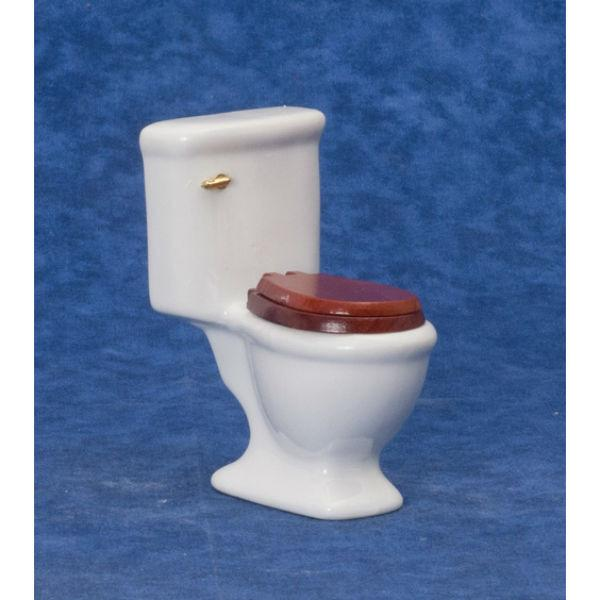 A white miniature porcelain toilet with brown lid.