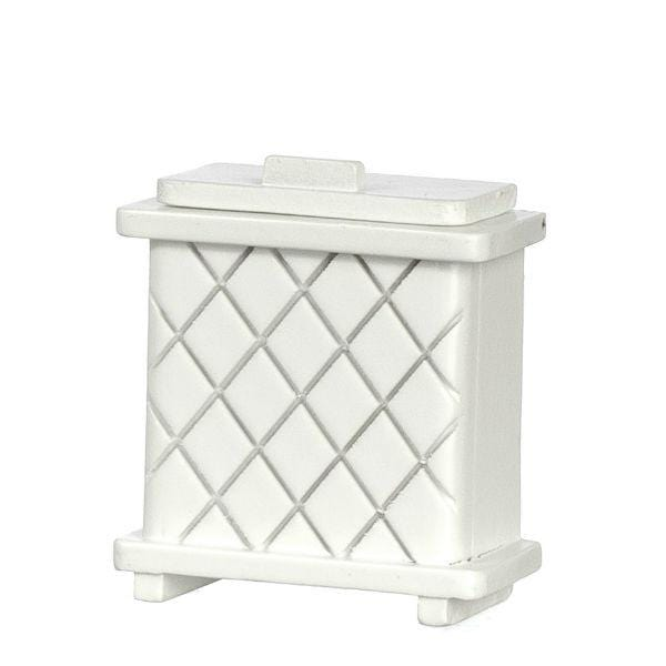 A dollhouse miniature clothes hamper in white.