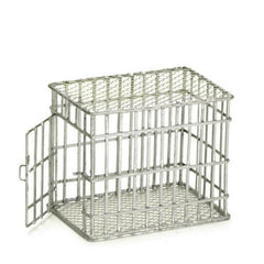 A dollhouse miniature metal dog cage.