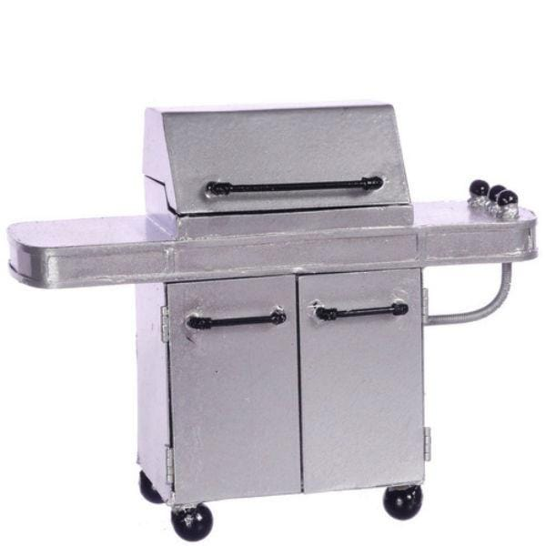 A dollhouse miniature grill in silver.