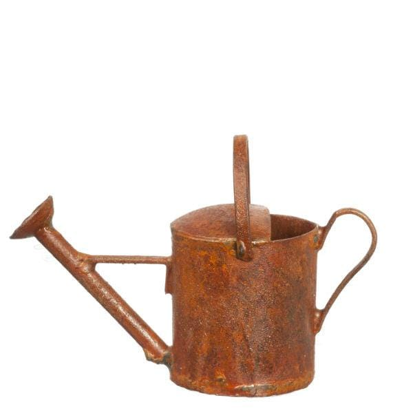 A dollhouse miniature watering can with a rusty finish.