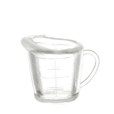 A dollhouse miniature clear measuring cup.