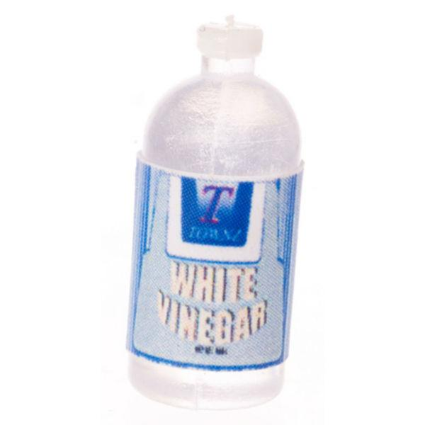 A bottle of dollhouse miniature white vinegar.