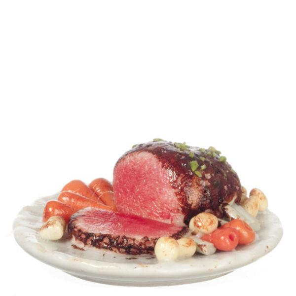 A dollhouse miniature platter of roast beef and vegetables.